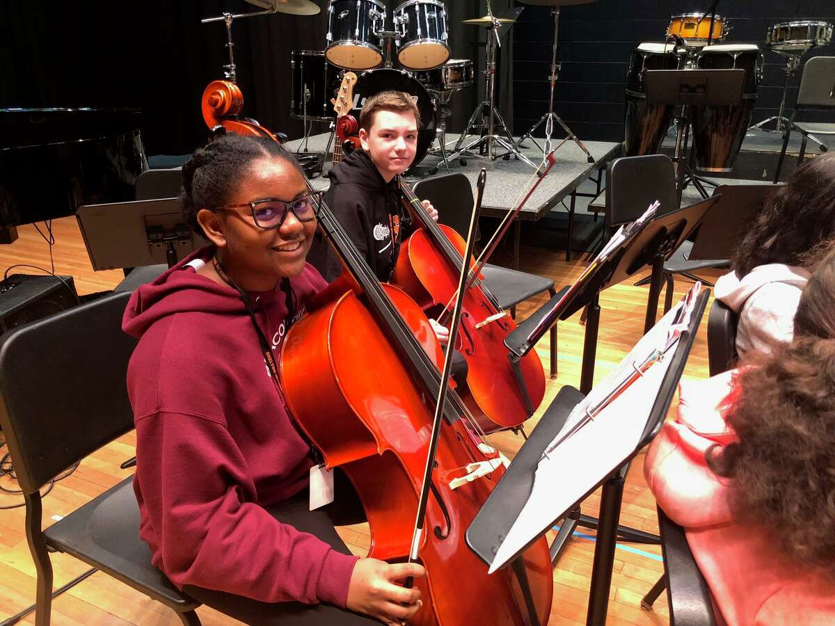 Cellists Madalyn Paige and Stephen Paul practice before their performance at the Shelton Intermediate School winter arts festival Thursday, Jan. 16.