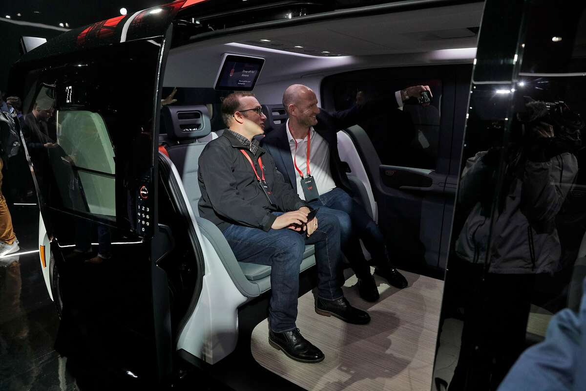 Apple's Adrian Perica, left, takes a selfie with SoftBank's Michael Ronen during the unveiling of Cruise's fully autonomous Origin passenger vehicle in San Francisco in January 2020.