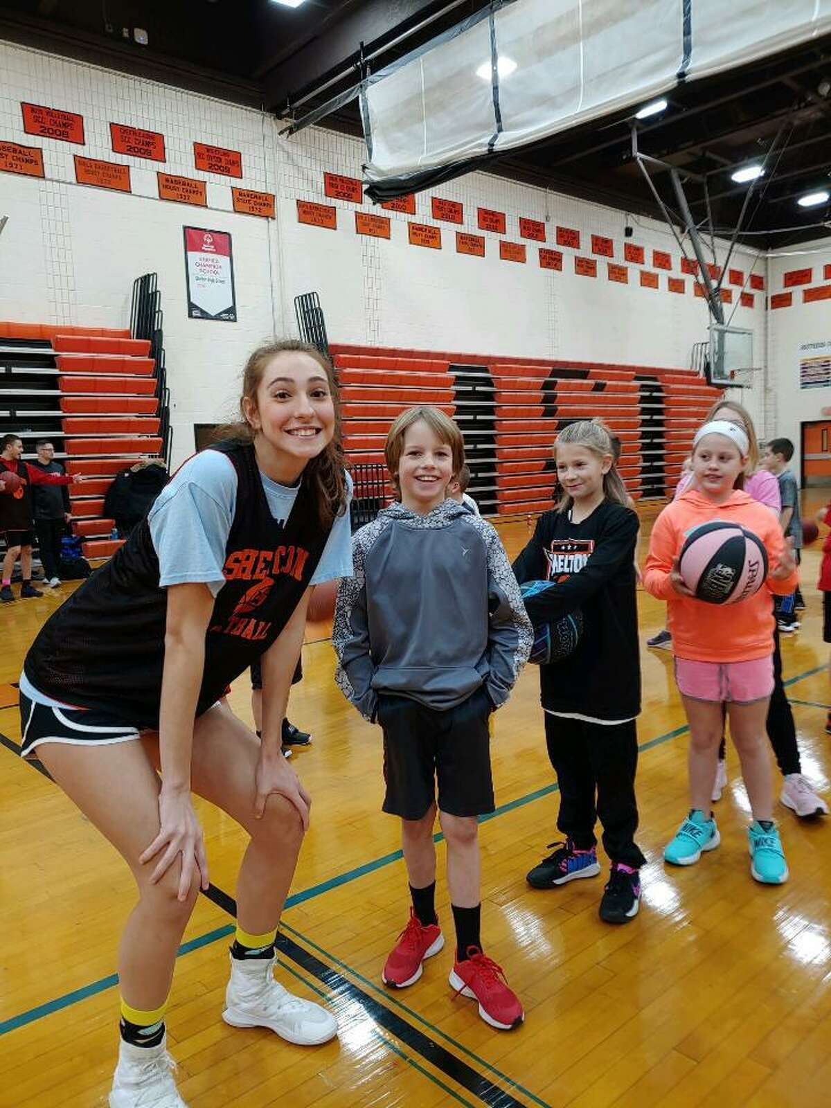 Shelton High varsity basketball players and coaches held a shooting clinic on Monday, Jan. 20. They taught younger kids basketball skills and collected food for the Audrey Dreyer Food Bank in the process.