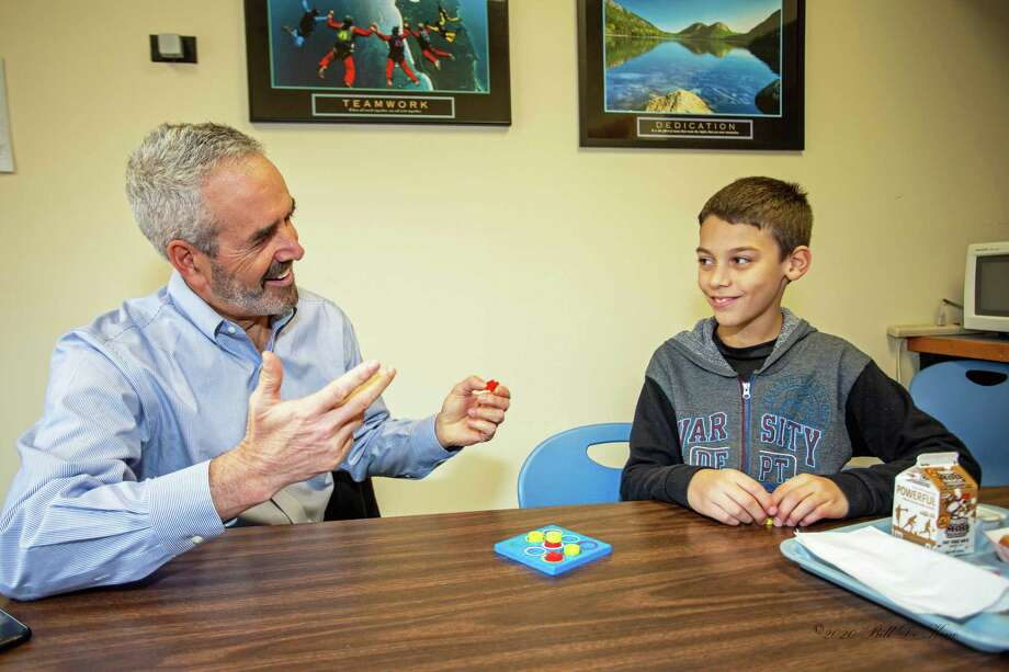 From left, mentor Marc Sadinsky and his mentee Zuriel, participate in the Middlesex County Chamber of Commerce Hal Kaplan Middletown Mentor Program, a partnership between the chamber and Board of Education. Photo: Contributed Photo / (c)DE KINE PHOTO LLC