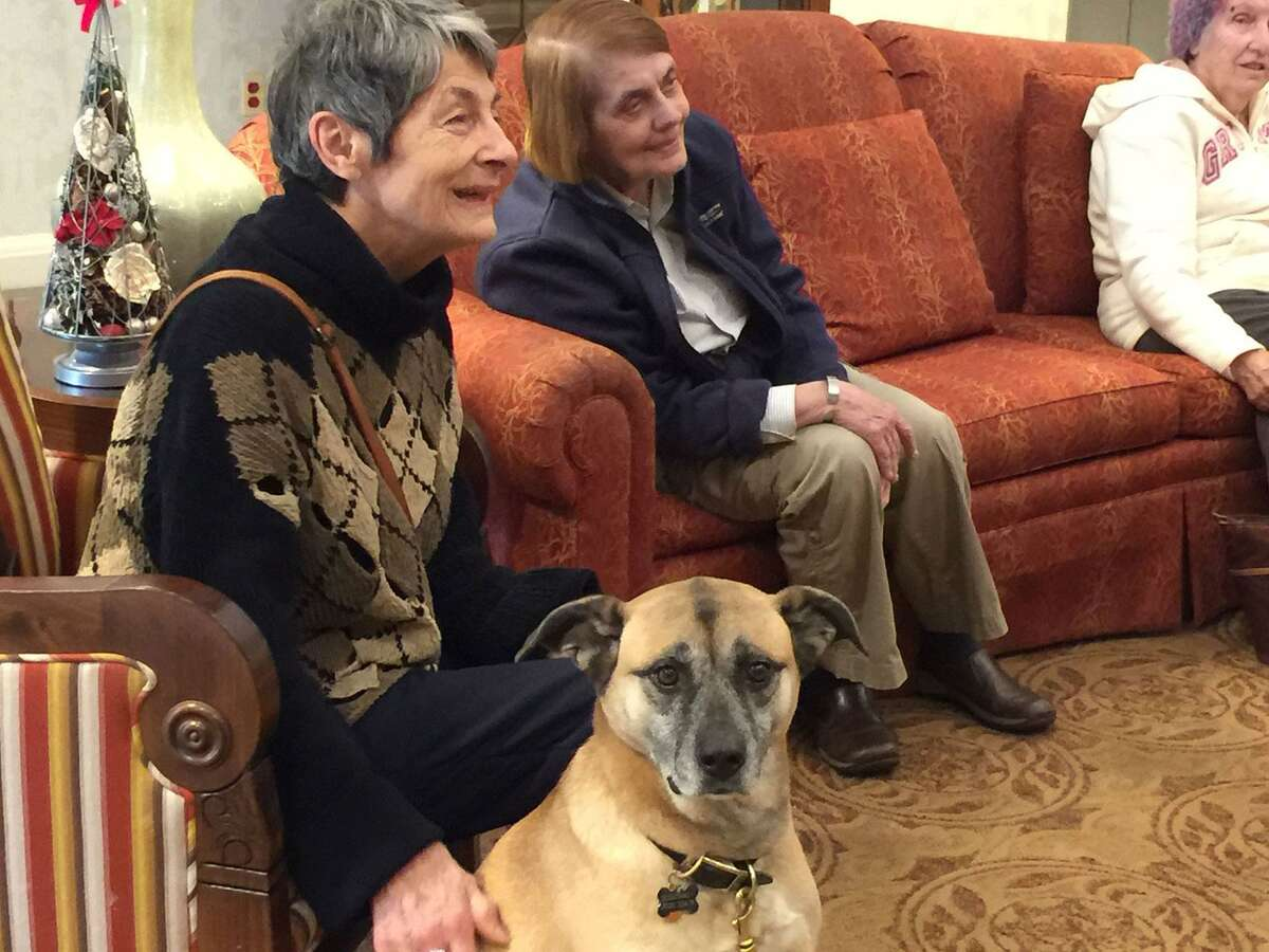 Enjoying a gathering room at The Greens at Cannondale are residents Vasilka Nicolova and her dog Binty (which means daughter in Swahili) and Val Kalaidjian.