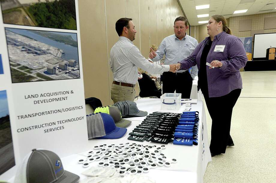 Fire-S Group's Brandon Ashley introduces co-worker Brandon Soileau to Jennifer Bigler at their booth during the Golden Pass LNG forum held at the Bob Bowers Civic Center in Port Arthur Tuesday. Area vendors, contractors and other business were invited to learn more about the Golden Pass LNG export project.  Photo taken Tuesday, June 18, 2019  Kim Brent/The Enterprise Photo: Kim Brent / The Enterprise / BEN