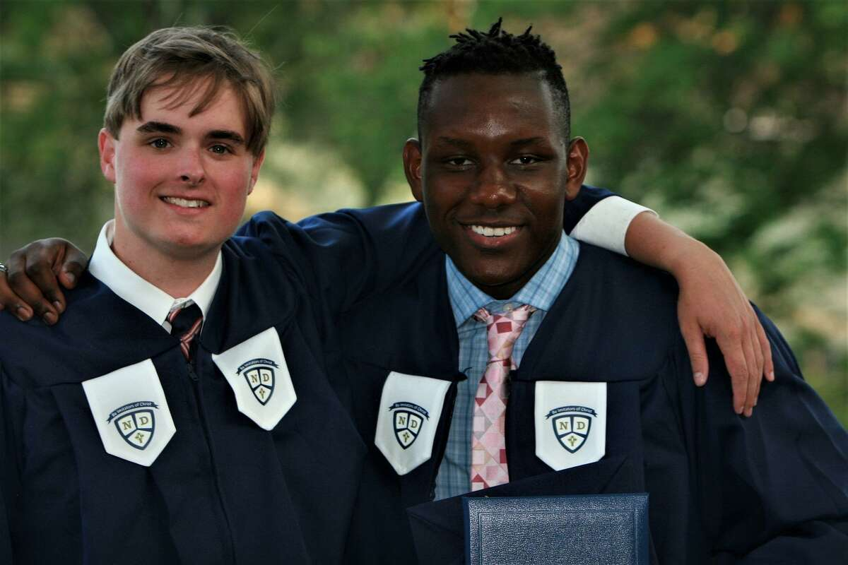 Jared Sullivan with Mubarak Soulemane at their graduation from Notre Dame Catholic High School in Fairfield.