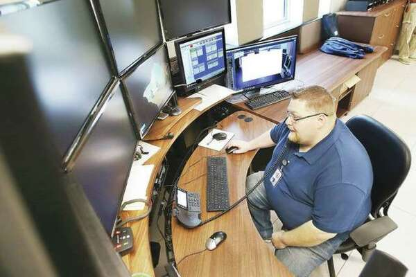 In this May 2019 file photo, Wood River Police 911 Supervisor Joe Petrokovich sits at one of the work areas in the dispatch center.