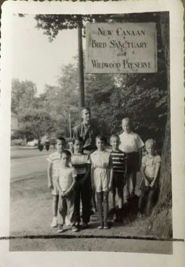 A group of young people at the entrance to New Canaan's Bristow Bird Sanctuary, which will celebrate its 100th anniversary in 2024. The New Canaan Planning and Zoming Commission backs the restoration of the bird sanctuary. Photo: Contributed Photo / New Canaan Advertiser Contributed
