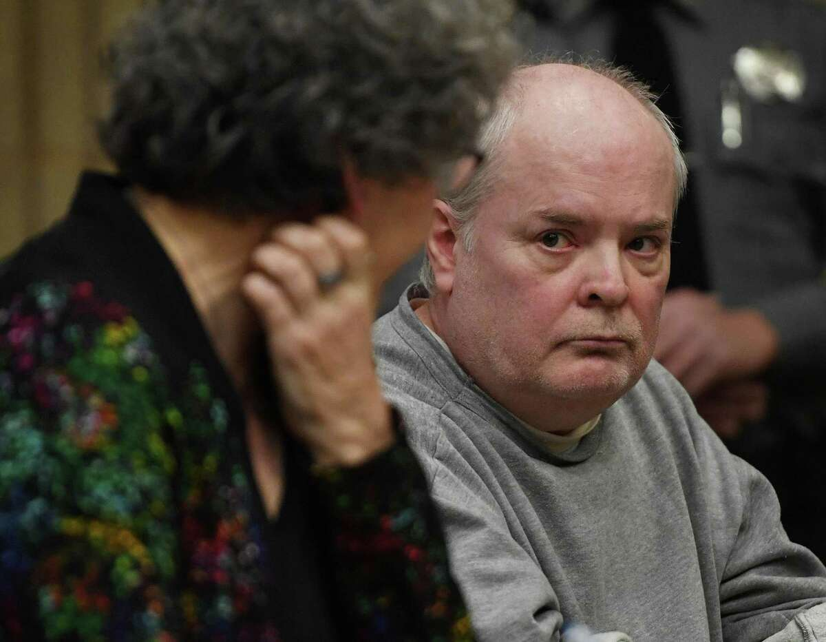 Russell Molleaur looks to his lawyer, Sue Brown, after his plea agreement was vacated in Superior Court in Milford, Conn. Wednesday, January 22, 2020.
