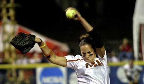 Texas' Cat Osterman pitches in the second inning against Alabama in an NCAA Women's College World Series game in Oklahoma City, Thursday, June 2, 2005. (AP Photo/Sue Ogrocki)