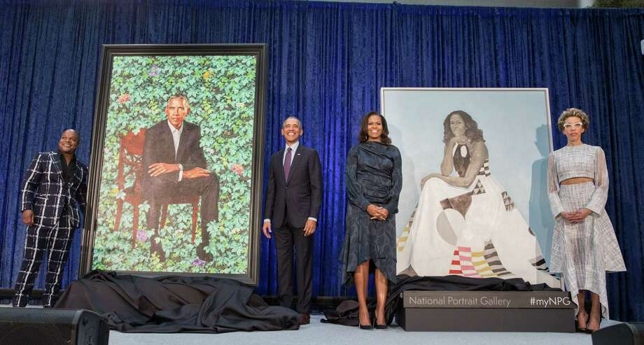 Artist Kehinde Wiley, from left, former President Barack Obama, former First Lady Michelle Obama and artist Amy Sherald at the Smithsonian's National Portrait Gallery on Monday, Feb. 12, 2018, after new portraits of the Obamas by the artists were unveiled. Photo: Pete Souza / Pete Souza / © 2018 Pete Souza