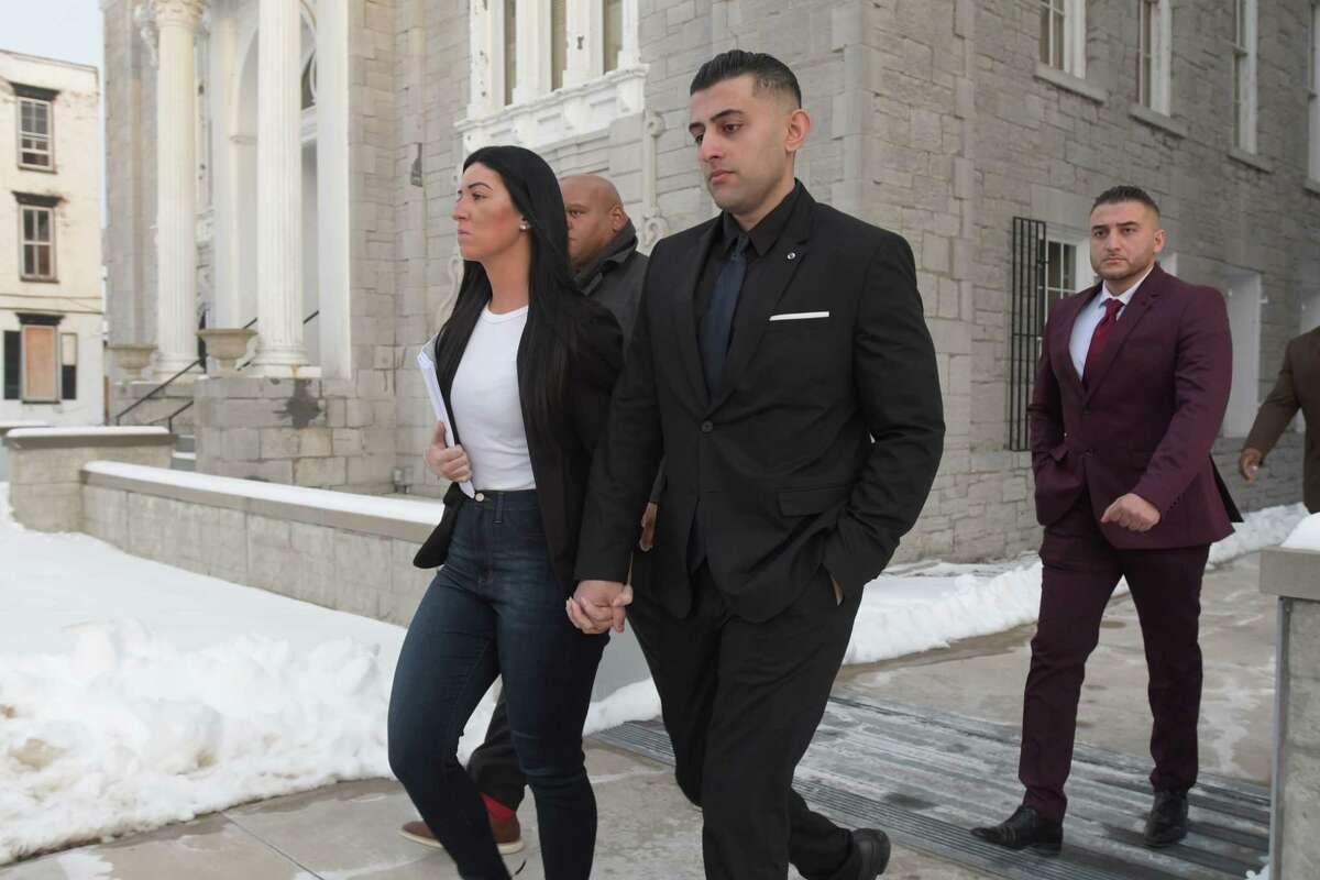 Nauman Hussain, right, walks out of the Schoharie County Court House following a pre-trail hearing on Wednesday, Jan. 22, 2020, in Schoharie, N.Y. Hussain is the operator of the company that owned the limousine that crashed in Schoharie County killing 20 people. (Paul Buckowski/Times Union)