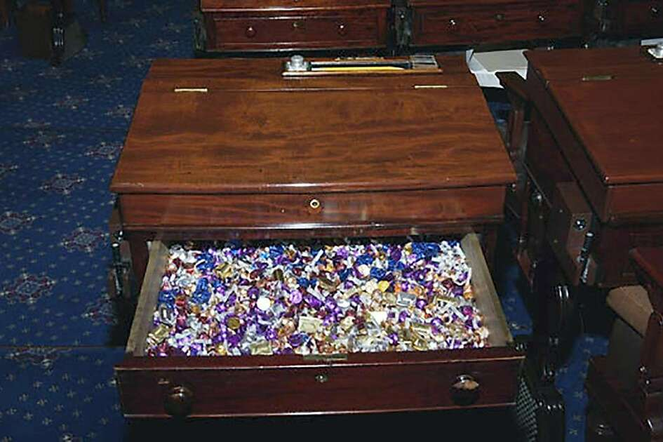 An image provided by the U.S. Senate shows the stash of candy in the desk of Sen. Patrick Toomey (R-Pa.), which is open to Republicans, Democrats and Independents. Under the chamber's staid rules, only milk, water and candy are allowed onto the Senate floor. (United States Senate via The New York Times) **EDITORIAL USE ONLY*