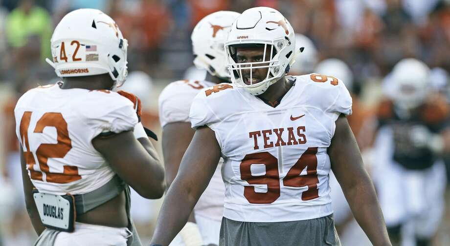 Defensive lineman Gerald Wilbon consults on the field with Marquez Bimage at the UT Orange-White Spring Game at DKR Stadium on April 21, 2018. Photo: Tom Reel/San Antonio Express-News