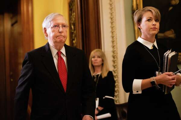 Senate Majority Leader Mitch McConnell, R-Ky., heads to the chamber for the Senate impeachment trial of President Donald Trump in Washington, D.C., on Jan. 21, 2020.