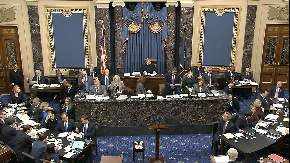 In this image from video, impeachment managers, lower left, and attorney's for Donal Trump, lower right, listen during the impeachment trial against President Donald Trump in the Senate at the U.S. Capitol in Washington, Tuesday, Jan. 21, 2020. At top is presiding officer Supreme Court Chief Justice John Roberts. (Senate Television via AP)