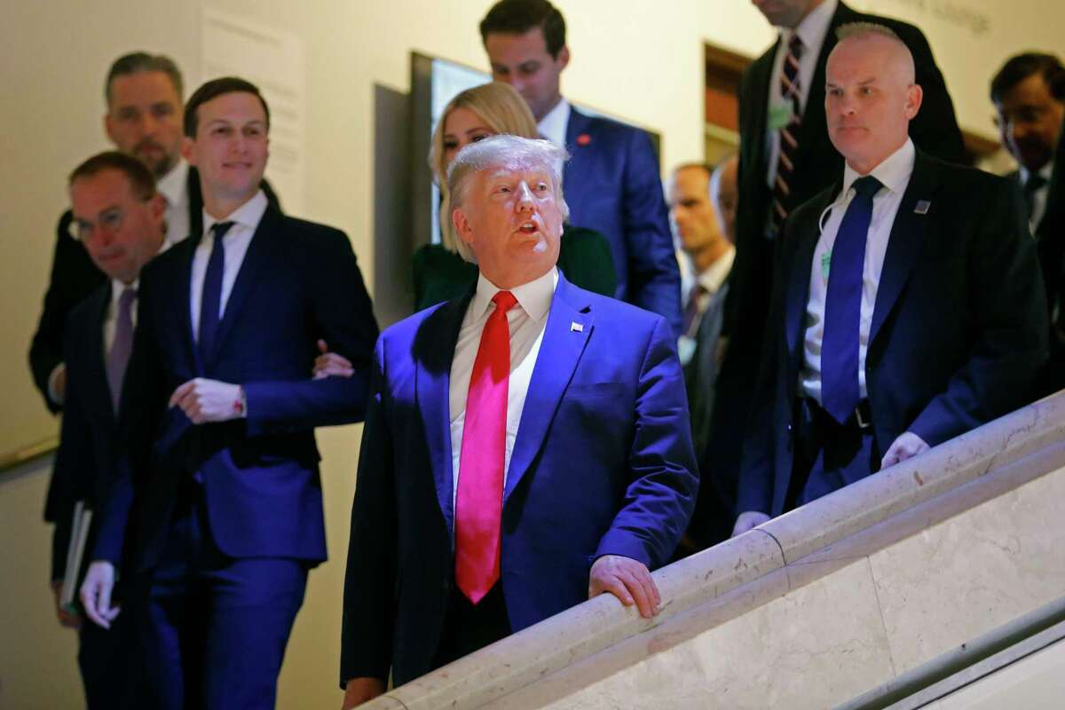 U.S. President Donald Trump, Jared Kushner, left, and Ivanka Trump, behind the President, leave the World Economic Forum in Davos, Switzerland, Tuesday, Jan. 21, 2020. The 50th annual meeting of the forum will take place in Davos from Jan. 21 until Jan. 24, 2020. (AP Photo/Markus Schreiber)