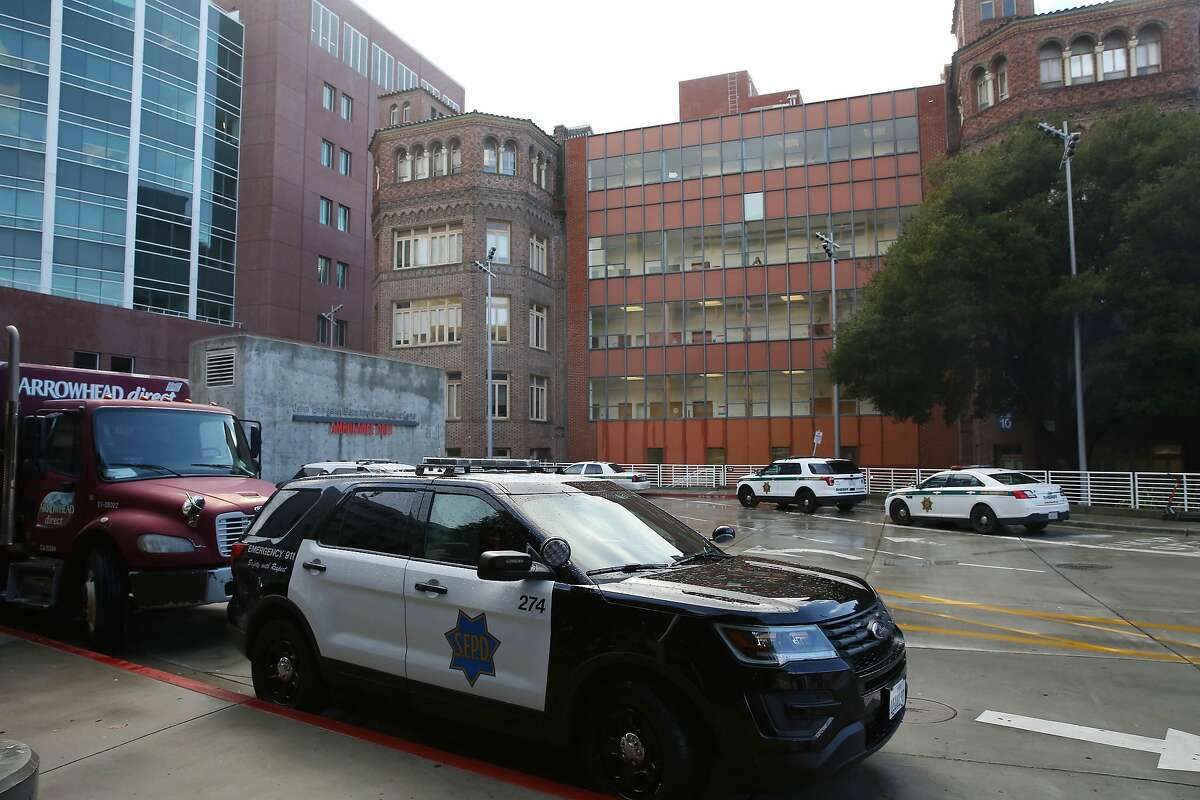 A San Francisco Police Department vehicle and San Francisco Sheriff's Department vehicles are seen outside the Zuckerberg San Francisco General Hospital and Trauma Center on Thursday, January 16, 2020 in San Francisco, Calif.