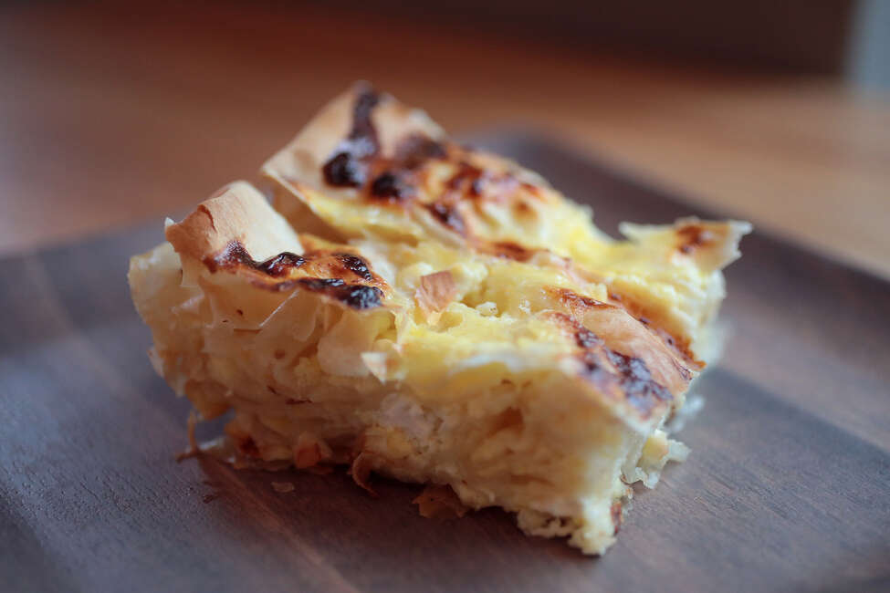 A slice of Balkan cheese pie made by Monica Obradovic, on December 9, 2019. (Cristina M. Fletes/St. Louis Post-Dispatch/TNS)