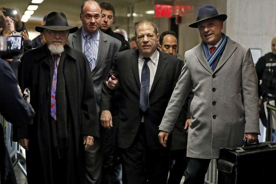 Harvey Weinstein, center, accompanied by attorney Arthur Aidala, right, arrives at court for his rape trial, in New York, Wednesday, Jan. 22, 2020. (AP Photo/Richard Drew) Photo: Richard Drew, Associated Press