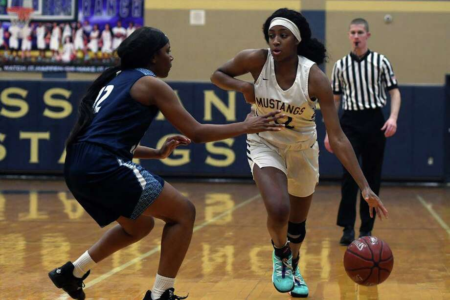 The Cy Ranch girls basketball team is attempting to capture its second straight District 14-6A title under head coach Megan Daniel. Photo: CFISD