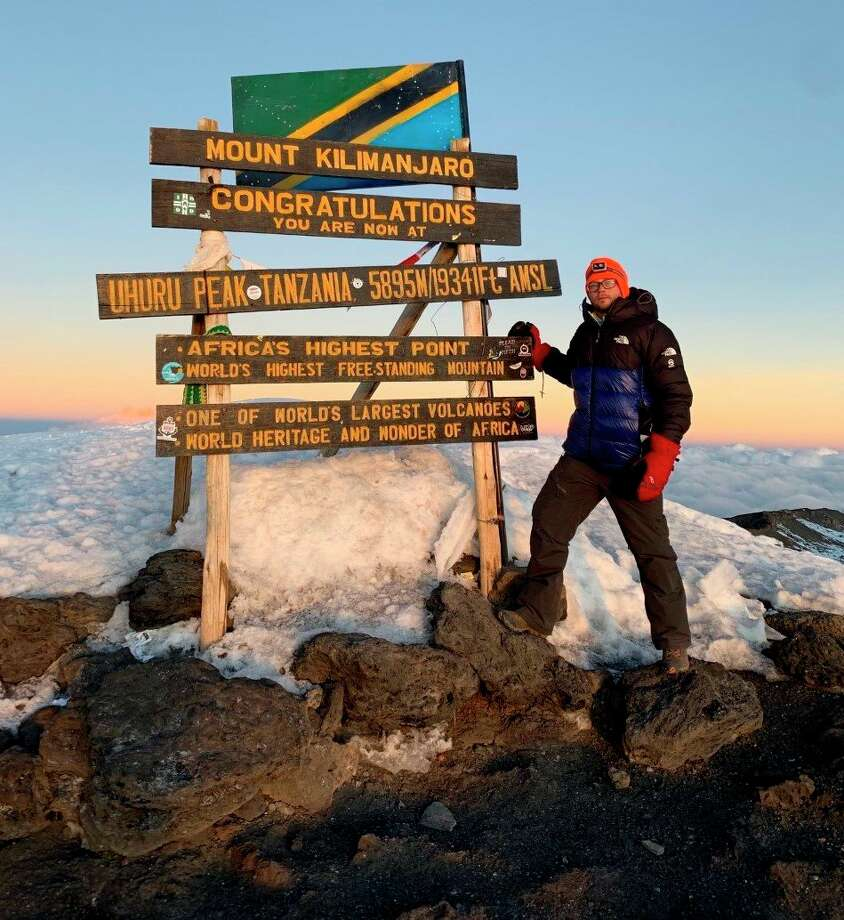 Manistee native Dominic Peterson poses at Uhuru Peak on Mt. Kilimanjaro during his climb to the peak last week. Peterson joined 23 others in climbing the mountain to help raise awareness and funds for the fight against Alzheimer's Disease. (Courtesy photo)