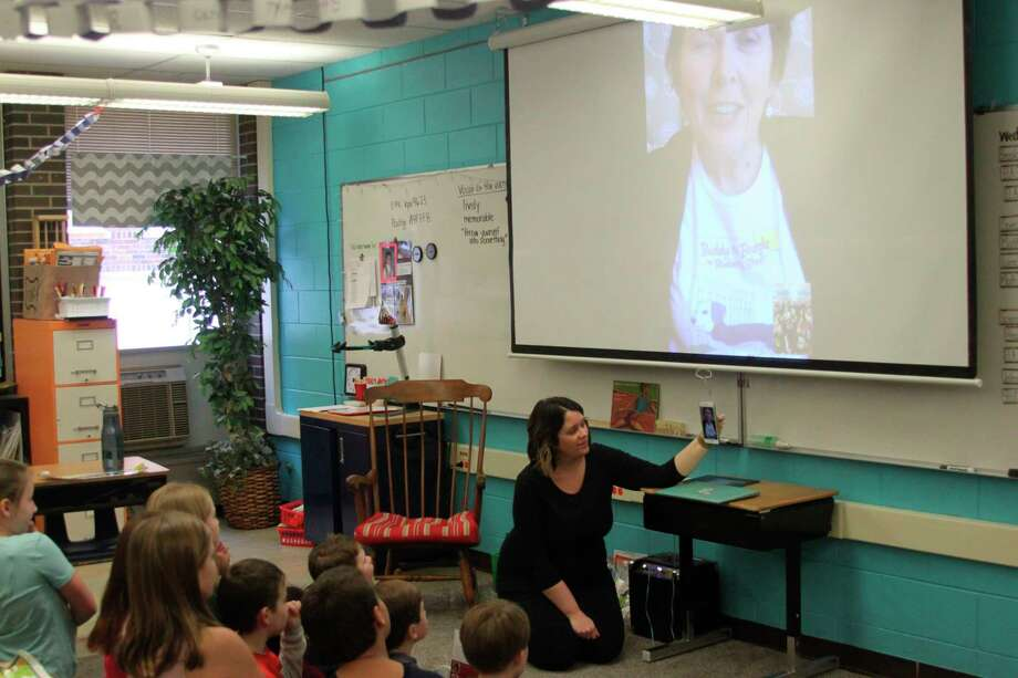 """Kennedy Elementary School third grade students in Jennifer Abel's class carry on a video chat conversation with Florida children's author Debbie Burton on what it takes to write a book. The students recently finished reading her book """"Buddy the Beagle on Blueberry Street."""" (Ken Grabowski/News Advocate)"""