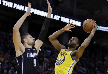Golden State Warriors' Alec Burks, right, shoots as Orlando Magic's Nikola Vucevic (9) defends during the second half of an NBA basketball game Saturday, Jan. 18, 2020, in San Francisco. (AP Photo/Ben Margot)