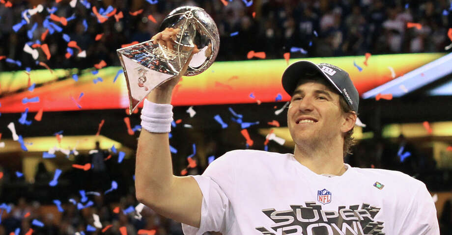 FILE -- Eli Manning of the New York Giants holds the Vince Lombardi Trophy after winning Super Bowl XLVI at Lucas Oil Stadium in Indianapolis, Feb. 5, 2012. Manning, who became a New York sports folk hero after he led the Giants to two upset victories in the Super Bowl, is retiring from the NFL, the team said on Jan. 22, 2020. (Doug Mills/The New York Times) Photo: DOUG MILLS/NYT