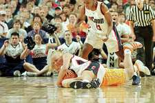 02 APR 2000: UCONN guard Shea Ralph scraps for the ball with Tennessee guard April McDivitt as UCONN guard Kennitra Johnson looks on during the NCAA Photos via Getty Images Division I Women's Basketball Tournament held at the Wells Fargo Center in Philadelphia, PA. The UCONN Huskies defeated the Tennessee Lady Volunteers 71-52 to win the national championship. Jamie Schwaberow/NCAA Photos via Getty Images
