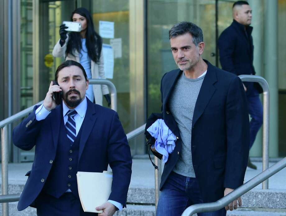 Fotis Dulos exits state Superior Court in Stamford with his attorney Kevin Smith on Jan. 9 after posting $6 million bond for the charge of murder of his wife, Jennifer Dulos. Photo: Erik Trautmann / Hearst Connecticut Media / Norwalk Hour