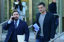 Fotis Dulos exits state Superior Court in Stamford with his attorney Kevin Smith on Jan. 9 after posting $6 million bond for the charge of murder of his wife, Jennifer Dulos.