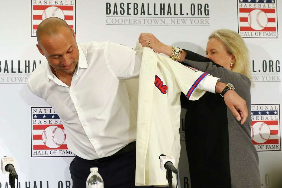 NEW YORK, NEW YORK - JANUARY 22: Derek Jeter puts on his Hall of Fame jersey after being elected into the National Baseball Hall of Fame Class of 2020 on January 22, 2020 at the St. Regis Hotel in New York City. The National Baseball Hall of Fame induction ceremony will be held on Sunday, July 26, 2020 in Cooperstown, NY. (Photo by Mike Stobe/Getty Images)