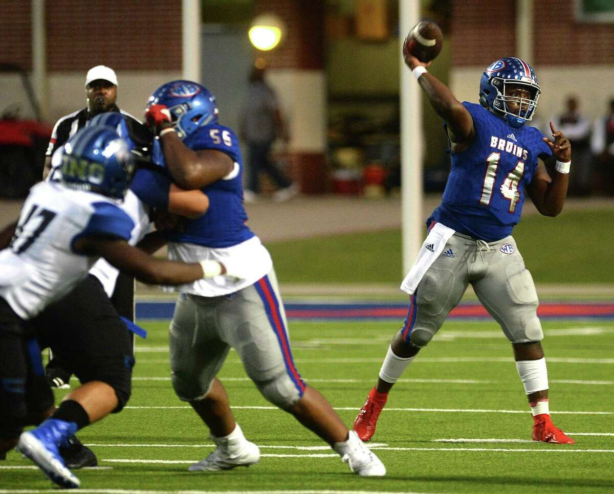 West Brook's Troy Yowman passes against C. E. King as he runs the ball during their homecoming game at Beaumont Memorial Stadium Friday. Photo taken Friday, September 27, 2019 Kim Brent/The Enterprise