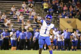 Hamshire-Fannett quarterback Marcus Morris lofts a pass to his wide receiver near the sideline for a long gain against the Liberty Panthers Friday night in their district win. Morris ran and passed to lead the Longhorns in the victory.