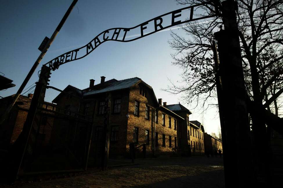 FILE - In this Dec. 6, 2019, file photo, the sun lights the buildings behind the entrance of the former Nazi death camp of Auschwitz-Birkenau in Oswiecim, Poland. World leaders will gather twice to mark the 75th anniversary of the liberation of the Auschwitz-Birkenau concentration camp _ once on Thursday, Jan. 23, 2020, in Jerusalem and again on Jan. 27 at the Auschwitz site in southern Poland. The fact that there will be two competing ceremonies reflects how politically charged World War II remains for nationalist governments in Russia and Poland. (Photo/Markus Schreiber, File)