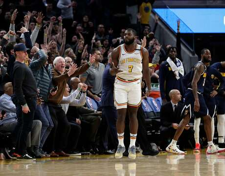 Eric Paschall (7) reacts after hitting a three point shot late in the second half as the Golden State Warriors played the Denver Nuggets at Chase Center in San Francisco, Calif., on Thursday, January 16, 2020.