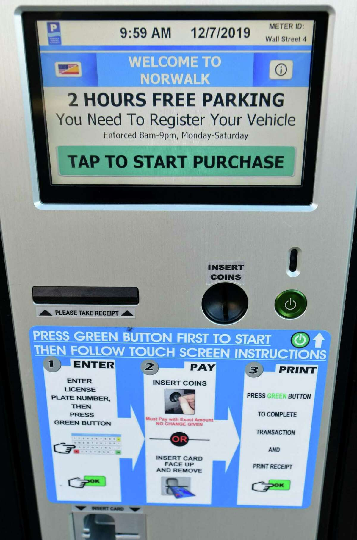 Parking kiosks stating free parking in the Wall Street area Saturday, December 7, 2019, in Norwalk, Conn. The city has suspended enforcement in the area until they can find a better solution for metered parking that will satisfy area businesses in the distict. The city has covered signs and to clarify parking is temporarily free and lines have been painted on High Street to delineate street parking within the Wall Street master parking plan.
