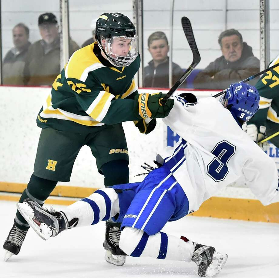 Hamden's Craig Cesare, left, and West Haven's Richie Green get physical during the first period on Wednesday at Bennett Rink in West Haven. Photo: Peter Hvizdak / Hearst Connecticut Media / New Haven Register