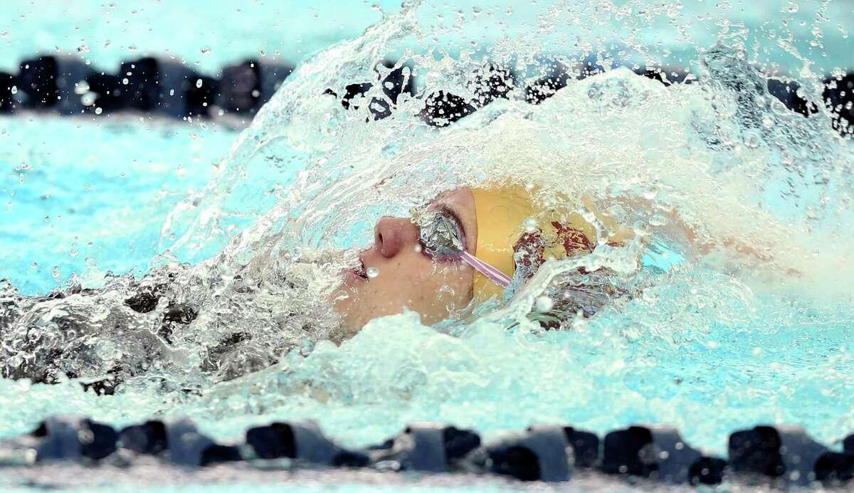 Morgan Schield wins the 100 backstroke for San Antonio Christian during the TAPPS regional swim meet at Bill Walker pools on Jan.22, 2020.