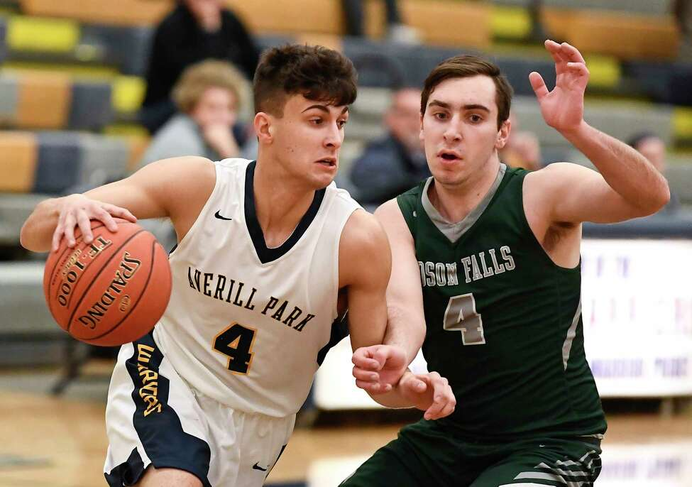 Averill Park's Ben Romer, left, moves the ball against the Hudson Falls' Brandon Pond during a boys' high school basketball game Wednesday, Jan. 22, 2020, in Averill Park, N.Y. (Hans Pennink / Special to the Times Union) ORG XMIT: 012320_hsbb_HP102