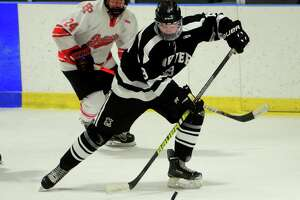 Xavier's Aden Hotchkiss intercepts the puck against Fairfield Prep in Bridgeport on Wednesday.
