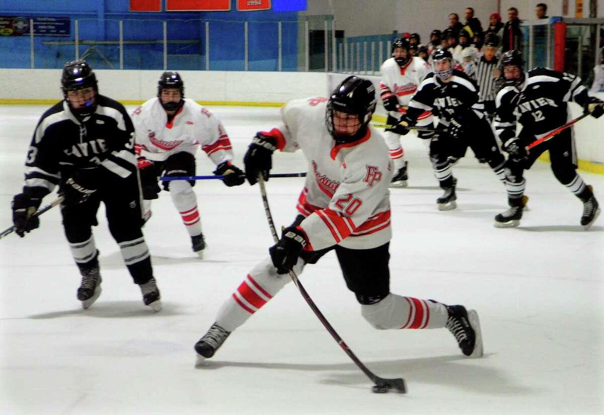 Fairfield Prep's Tiernan Curley (20) hits a goal shot to score against Xavier during boys high school ice hockey action in Bridgeport, Conn., on Wednesday Jan. 22, 2020.