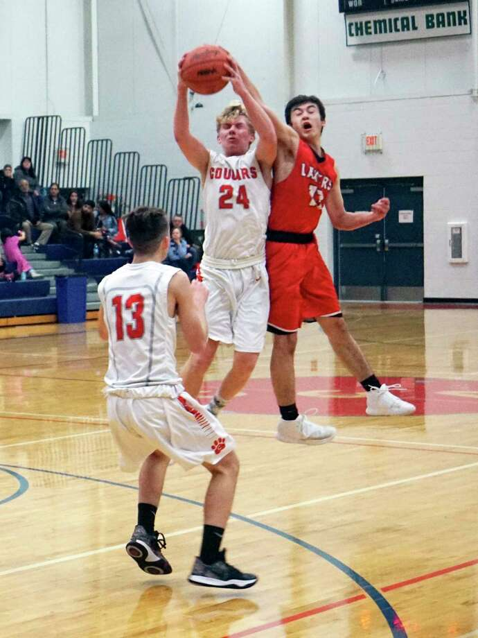 Cameron Carnes leaps to intercept a pass during CCA's 59-45 loss to Bear Lake on Wednesday evening. (Pioneer photo/Joe Judd)