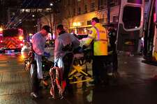 Emergecny personnel transport shooting victim in downtown on January 22, 2020 in Seattle, Washington. As many as seven people have been reportedly injured and police are still searching for the suspect. (Photo by Chris Porter/Getty Images)