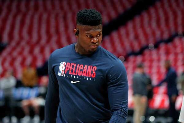 New Orleans Pelicans forward Zion Williamson warms up before an NBA basketball game San Antonio Spurs in New Orleans, Wednesday, Jan. 22, 2020. It is the first overall draft pick's regular season NBA debut after being injured since preseason. (AP Photo/Gerald Herbert)