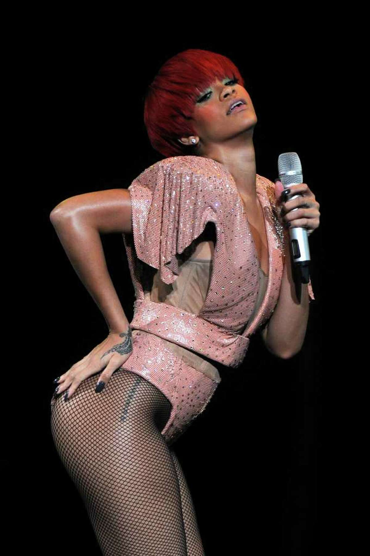 NEW YORK - AUGUST 12: Singer Rihanna performs at Madison Square Garden on August 12, 2010 in New York City. (Photo by Bryan Bedder/Getty Images) *** Local Caption *** Rihanna