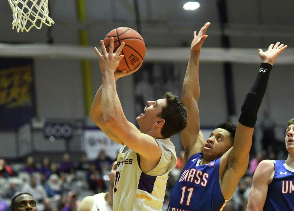 University at Albany's Cameron Healy drives to the basket pastLowell's Obadiah Noel during a game at SEFCU Arena on Wednesday, Jan. 22, 2020 in Albany, N.Y. (Lori Van Buren/Times Union)