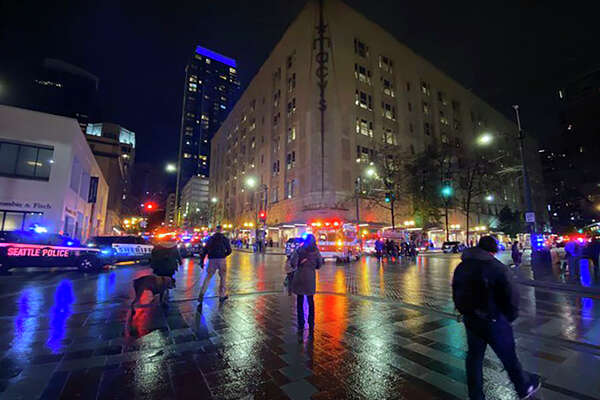This photo provided by Suzanne Asprea shows the area of a deadly shooting in downtown Seattle on Wednesday, Jan. 22, 2020. A gunman opened fire in downtown Seattle on Wednesday night, killing at least one person and wounding several others, authorities said. Police Chief Carmen Best said what they believe is a lone suspect fled and police are searching for him. (Suzanne Asprea via AP)