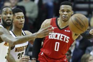Houston Rockets guard Russell Westbrook (0) passes the ball during the second half of an NBA basketball game at Toyota Center in Houston, Wednesday, Jan. 22, 2020.