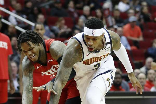 Houston Rockets guard Ben McLemore (16) battles for a loose ball with Denver Nuggets forward Torrey Craig (3) during the first half of an NBA basketball game at Toyota Center in Houston, Wednesday, Jan. 22, 2020.