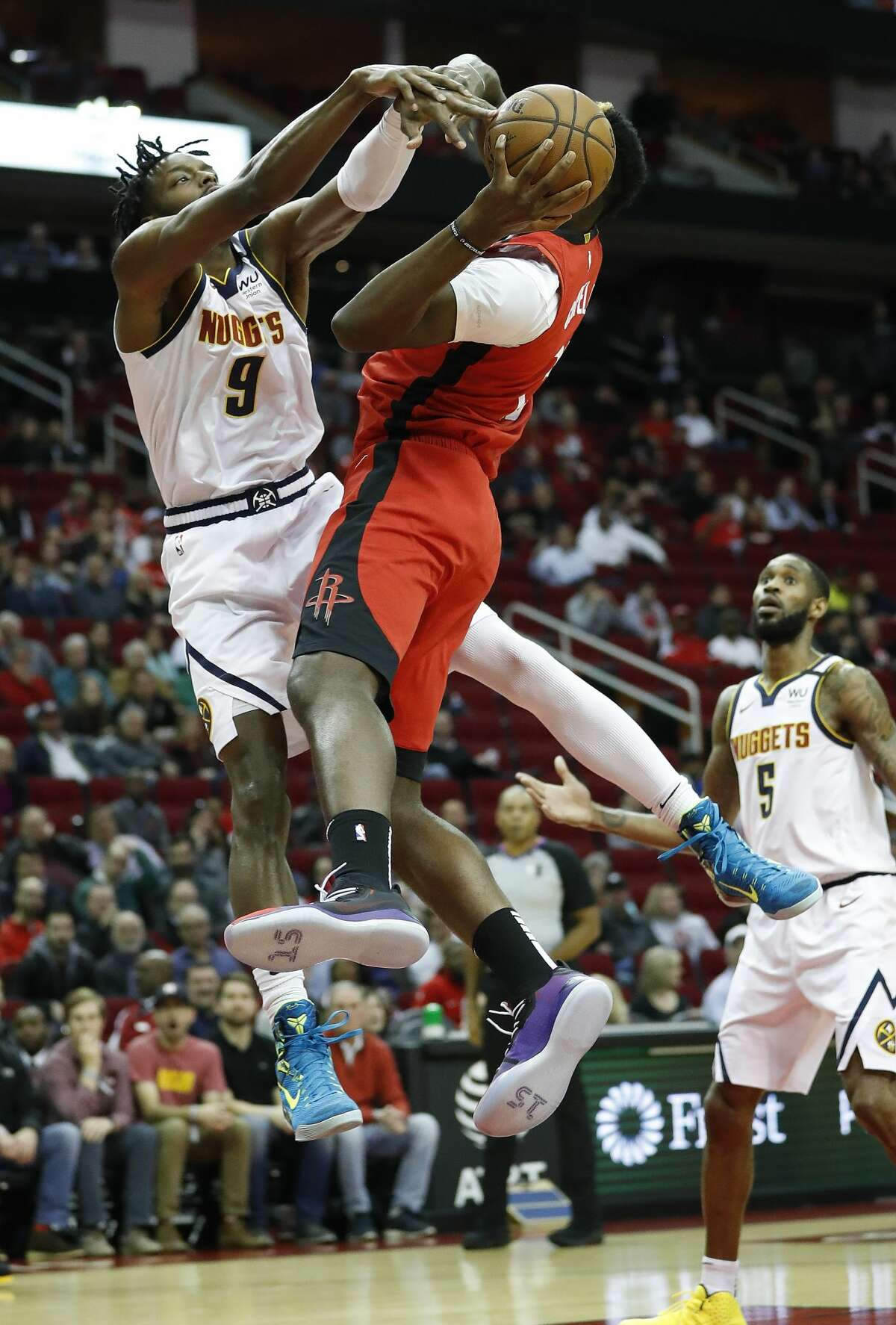 Houston Rockets center Clint Capela (15) goes up for a basket against Denver Nuggets forward Jerami Grant (9) during the first half of an NBA basketball game at Toyota Center in Houston, Wednesday, Jan. 22, 2020.