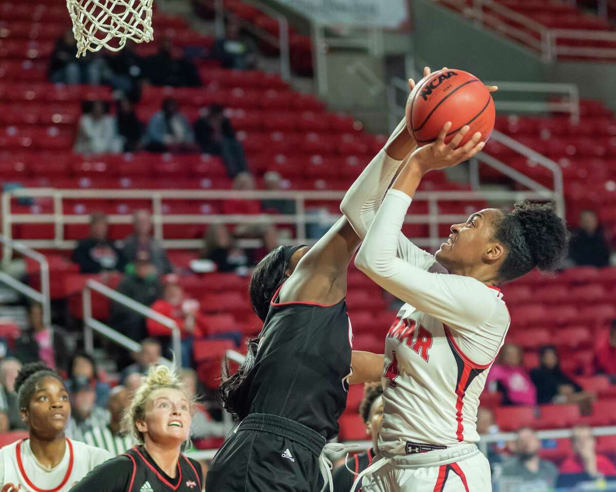 Briana Laidler (4) goes airborne with a pass in the second half as the Lady Cardinals fell to the Cardinals of the University of the Incarnate Word on Wednesday, January 22, 2020. Fran Ruchalski/The Enterprise